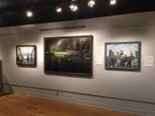 """De gauche à droite: """"Destruction de mines"""" de Donald C. Mackay; """"Destroyers canadiens de classe Tribal en plein combat"""" de Tony Law ; et """"Canon antiaérien et équipage en action"""" de Donald C. Mackay"""